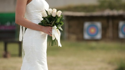 Bride standing with a bouquet and waiting for the groom
