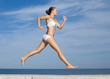 Sportswoman running outdoors