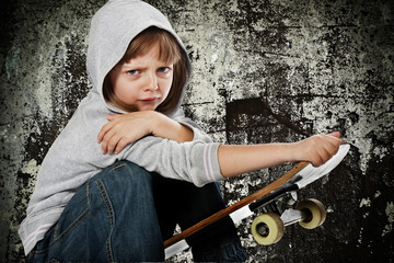 angry rebellious girl with skateboard