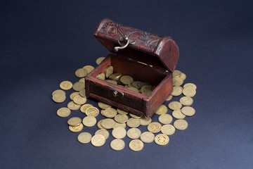 Old wooden chest with coins