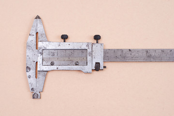 Vernier calipers isolated on old paper background