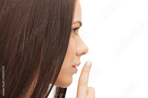 picture of woman with finger on lips