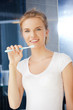 smiling teenage girl with toothbrush