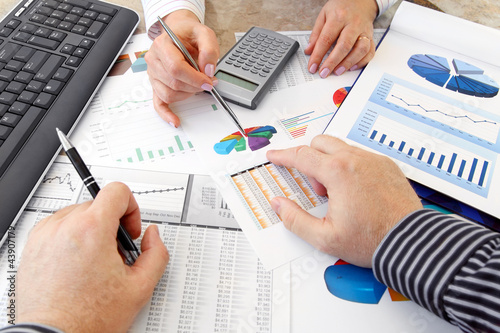 Hands with Financial  Charts  at Business Meeting