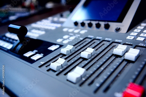 controls of audio mixing console
