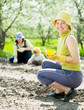 women and kid sows seeds