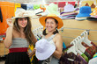 women  chooses hat at  shop