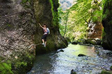 Woman climbing mountain wall