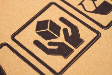 black symbol on cardboard