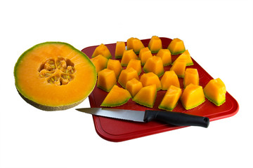 Cantaloupe Pieces and Half Fruit on a Cutting Board