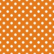 Seamless vector pattern with white polka dots orange background