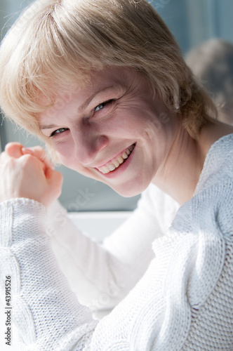 happy laughing middle-age woman in white