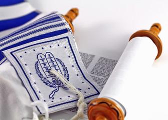 Jewish Tallit Prayer Shawl Over Torah Scroll