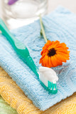 Toothbrush with toothpaste on fresh towels - 43925121