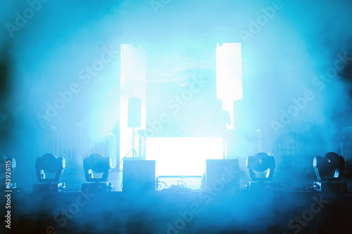Empty concert stage in disco lights and smoke