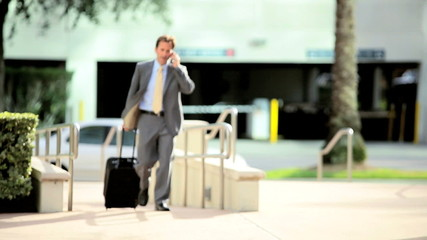 Businessman on Smart Phone Returning Travel