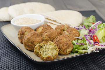 Falafel - Deep fried chickpeas balls with tahini, salad & pitta