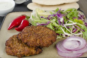 Shami Kebab - Spicy lamb patties with mint raita, salad & pitta