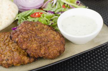 Shami Kebab - Spicy lamb patties mint raita, salad & pitta