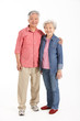 Full Length Studio Shot Of Chinese Senior Couple