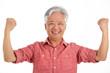 Studio Shot Of Jubilant Chinese Senior Man