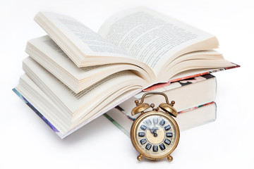 Time for school. Alarm clock and books