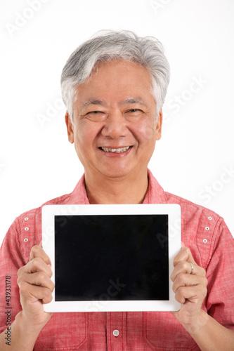Studio Shot Of Chinese Senior Man Holding Digital Tablet