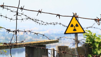 Radiation symbol and barbed wire.