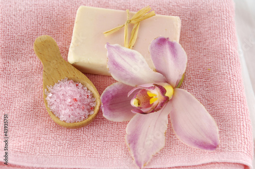 Spa products with orchid flowers and candle