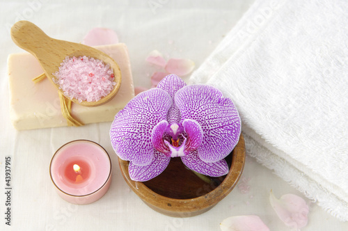 Spa products with orchid flowers and candle,