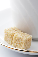 Two cubes of cane sugar