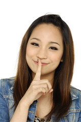 picture of girl with her hand over her mouth