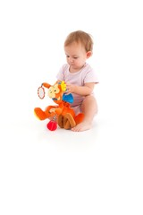 Baby girl playing with soft toy