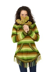 Happy young woman with autumn leaf