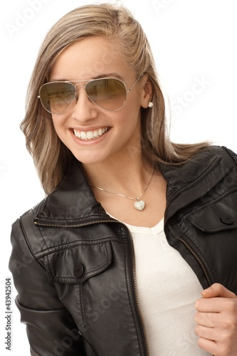 Happy girl in trendy leather jacket