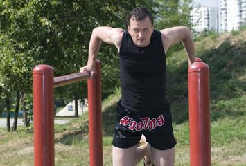 The athlete trains on bars