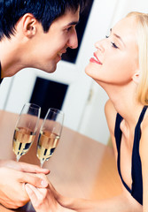 Couple with champagne at restaurant