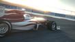 Formula One race car on desert circuit passing camera