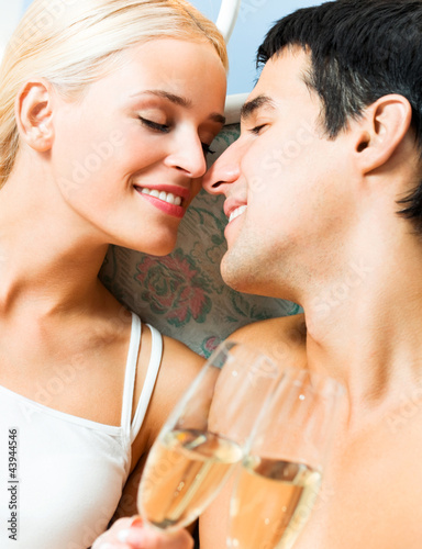 Cheerful couple with glasses of champagne