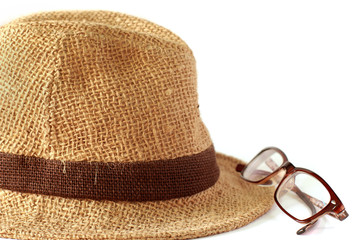 Summer straw hat with glasses on white background