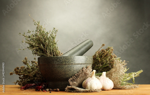 dried herbs in mortar and vegetables,
