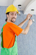 Electrician repairman working on refurbishment