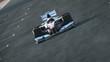 Formula One race car on desert circuit - finish line