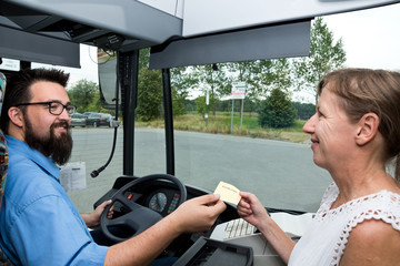 Busdriver and paying Woman laughing