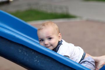 Child climbing up slide