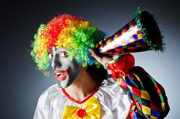 Funny clown in studio shooting