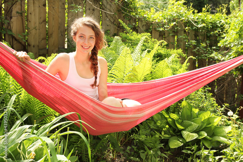 Girl sit in a hammock