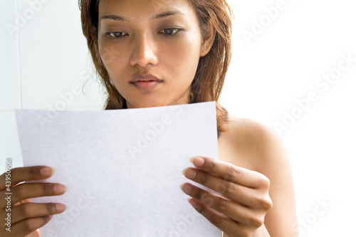 Young woman reading a letter..