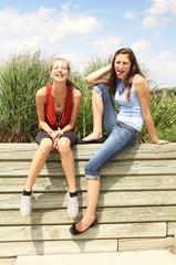 Teenagers sit outside