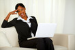 Charming business black woman on laptop